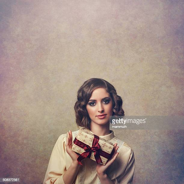 retro girl holding christmas gift