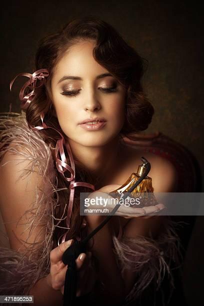 retro girl holding perfume bottle