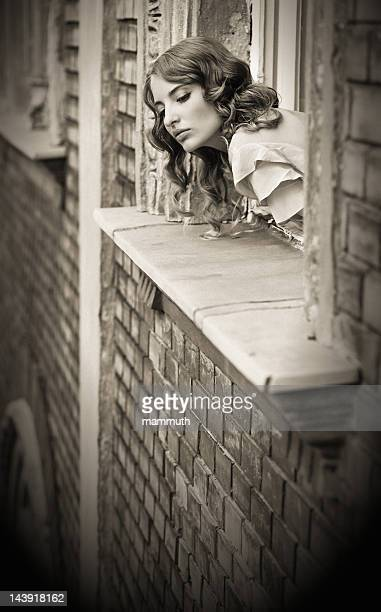 retro girl looking out of the window - man made age stock pictures, royalty-free photos & images