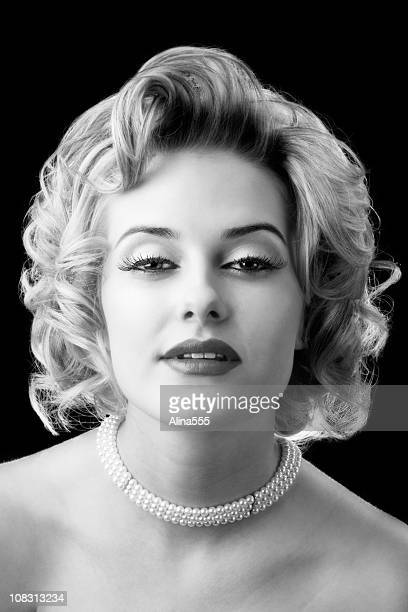Retro glamor portrait of young beautiful blond woman