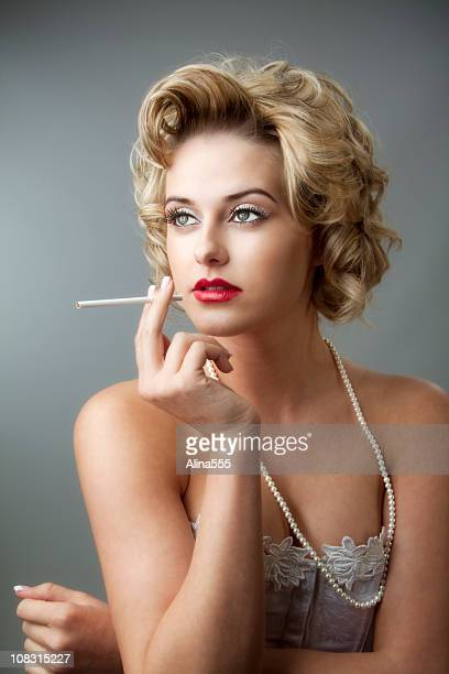 retro glamor portrait of young beautiful blond woman with cigarette - beautiful women smoking cigarettes stock photos and pictures