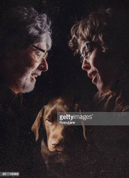 retro glamour shot of couple and pet - freaky couples stock photos and pictures