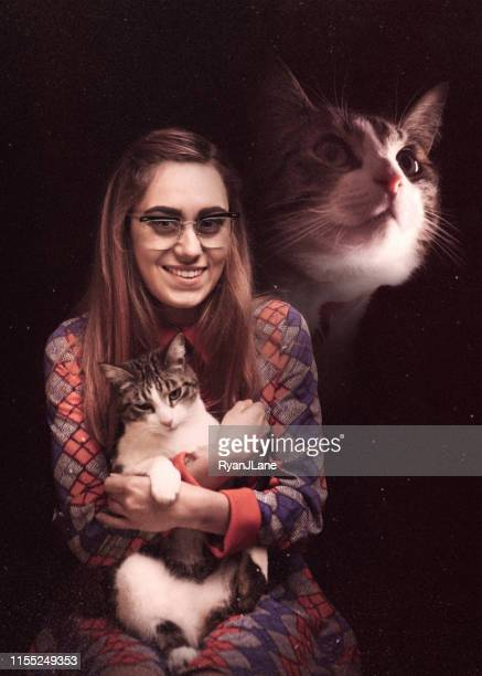retro glamour shot of woman with pet cat - bizarre photos stock pictures, royalty-free photos & images
