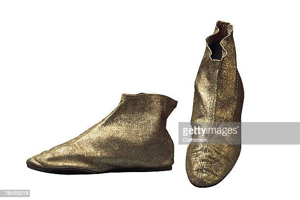 retro gold slippers - gold shoe stock photos and pictures
