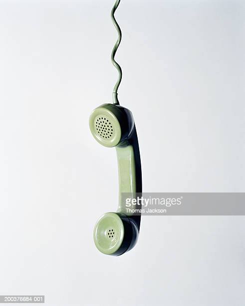 Retro green telephone receiver with cord extended
