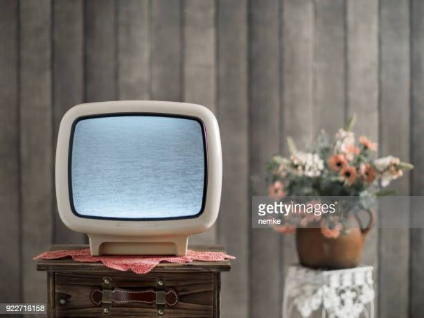 Retro grunge tv against wallpaper wall