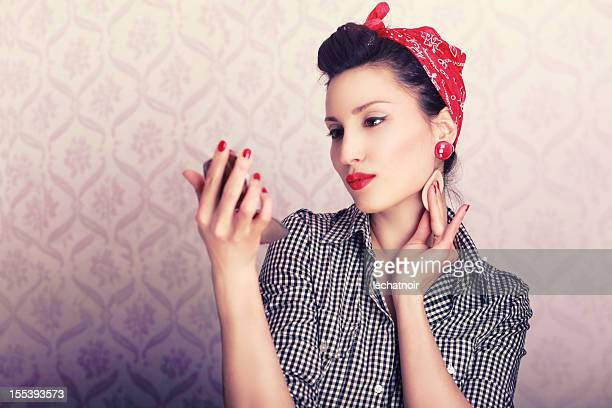 retro housewife applying makeup - 1940s erotica stock photos and pictures