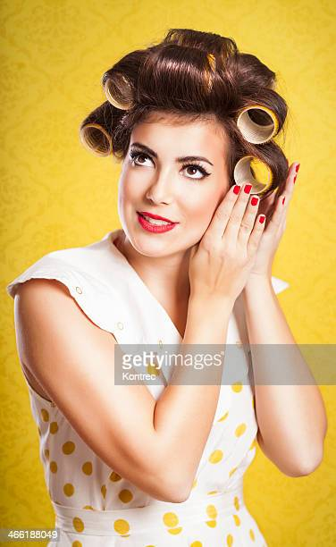 Retro housewife fixing up her hair