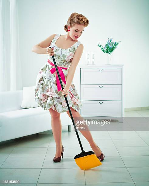 Retro housewife sweeping