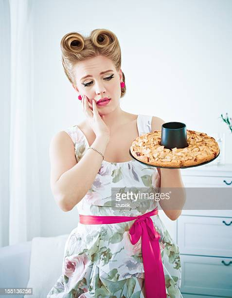 Retro housewife with failed pie