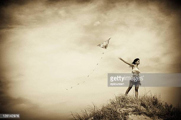 Retro image of woman flying a kite