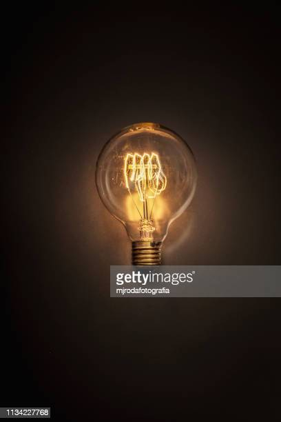 retro light bulb - resplandeciente stock pictures, royalty-free photos & images