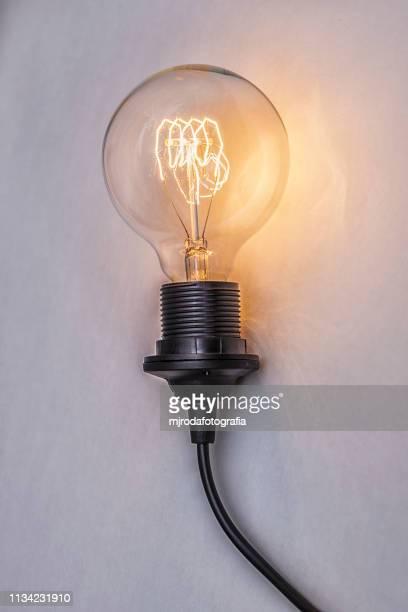 retro light bulb - imaginación stock pictures, royalty-free photos & images