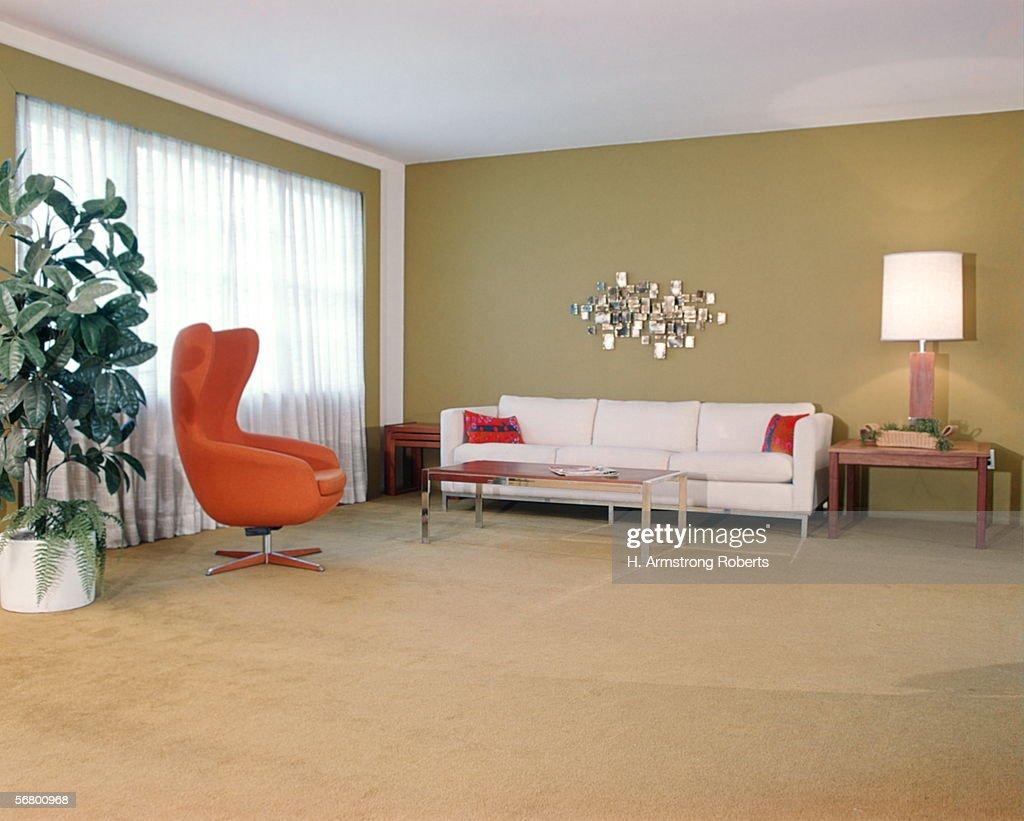 Retro Living Room Interior With Orange Chair And White Sofa