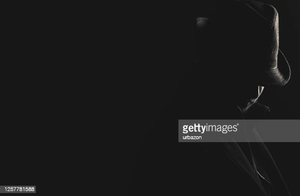 retro man in hat wears coat and hat - privateinvestigator stock pictures, royalty-free photos & images