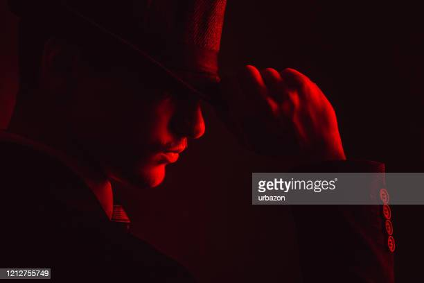retro man in hat wears suit and tie - organized crime stock pictures, royalty-free photos & images