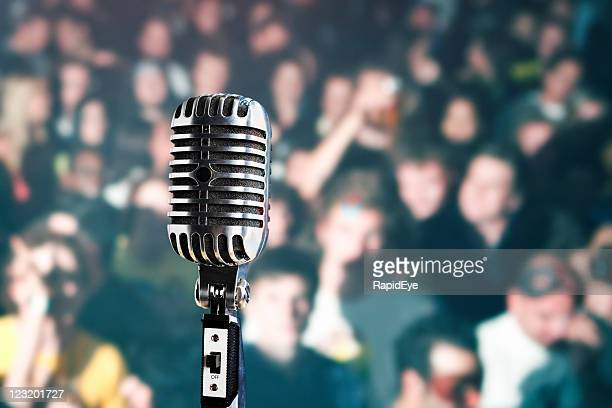 Retro microphone in front of audience
