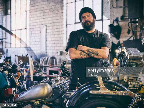retro motorcycle mechanic - motorcycle biker stock pictures, royalty-free photos & images