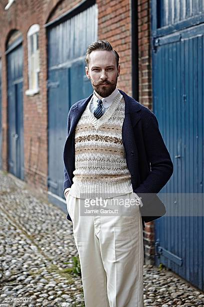 retro moustached male with hands in pocket - cardigan sweater stock pictures, royalty-free photos & images