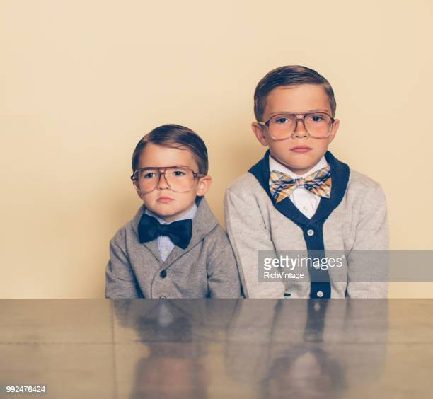 retro nerd boys with bored expressions - sibling stock pictures, royalty-free photos & images