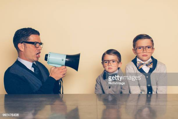 retro nerd children not listening to dad - bossy stock pictures, royalty-free photos & images