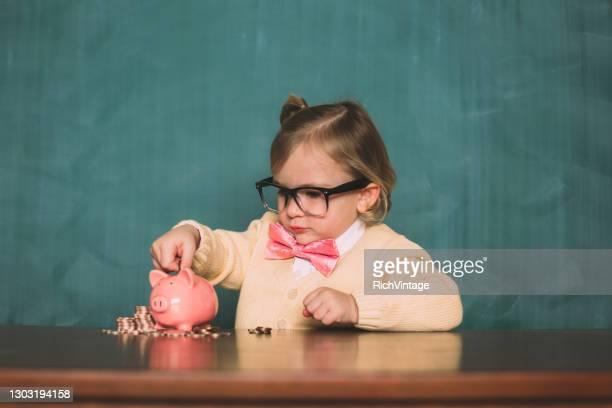 retro nerd girl saving money - adult imitation stock pictures, royalty-free photos & images