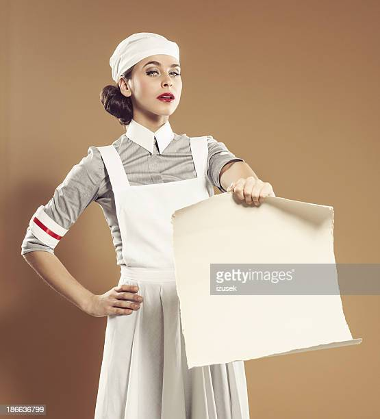 retro nurse with announcement - nursing slogans stock photos and pictures