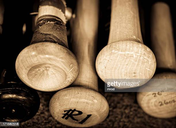 retro photo of old baseball bats inscribed - baseball bat stock pictures, royalty-free photos & images