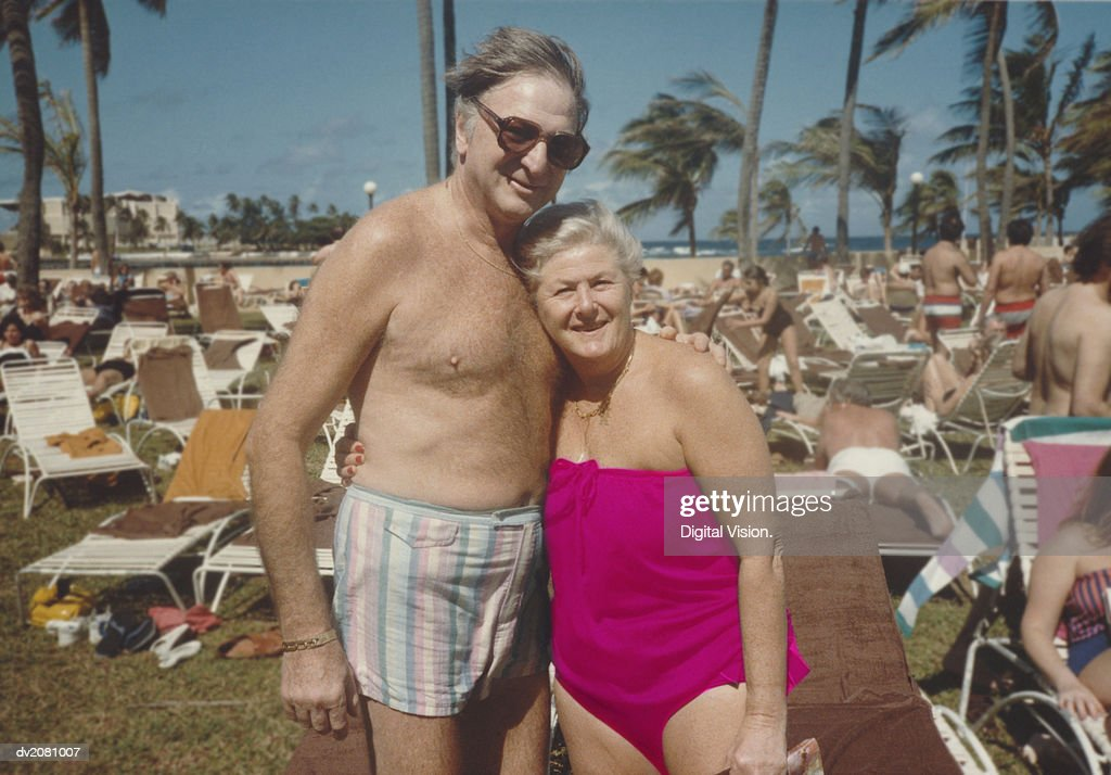 Retro Photograph of a Senior Couple in Swimwear, Standing by Sun Loungers : Stock Photo