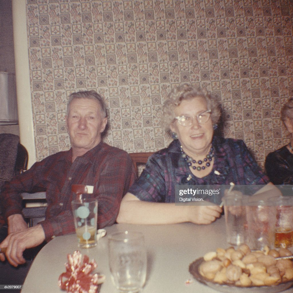 Retro Photograph of a Senior Couple Sitting at a Table : Stock Photo