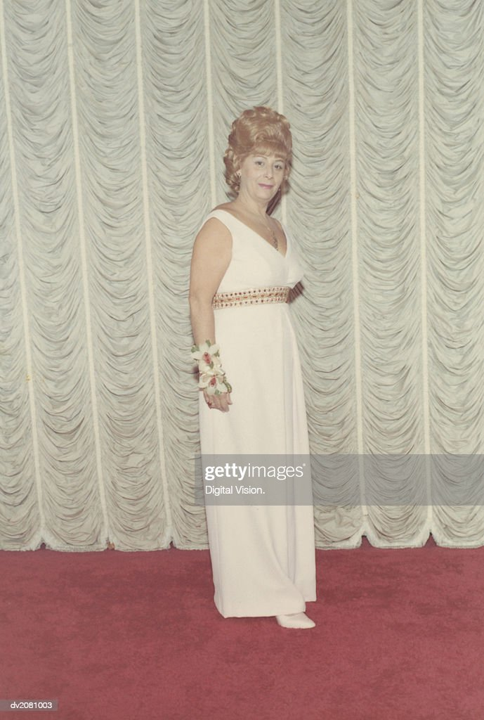 Retro Photograph of a Woman in an Evening Gown and Corsage : Stock Photo