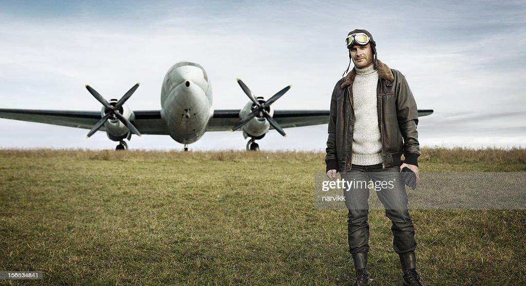Retro pilot and his airplane : Stock Photo