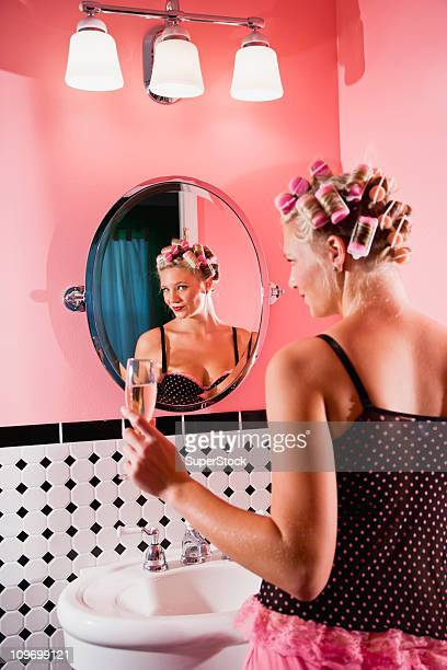 Retro pin-up girl with curlers in hair