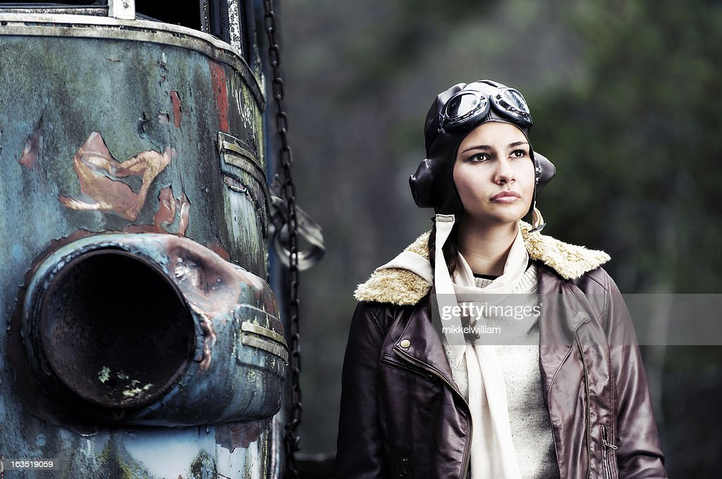 Retro portrait of a female aviator : Stock Photo