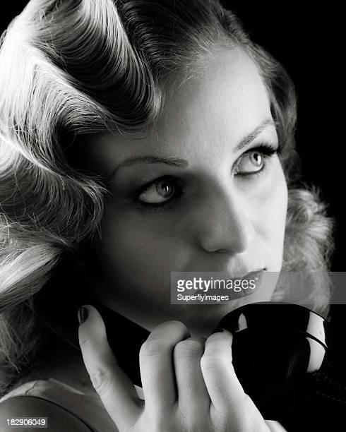 Retro Portrait of Woman on Old Telephone. Film-noir B&W.