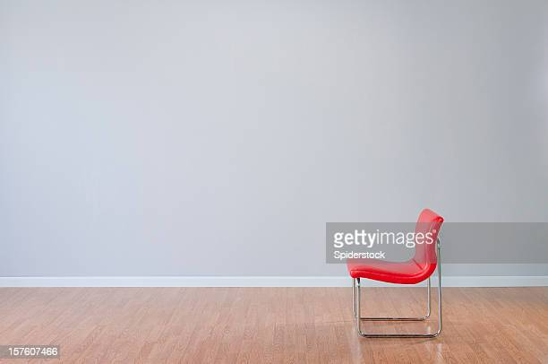 retro red chair in empty room - wainscoting stock photos and pictures