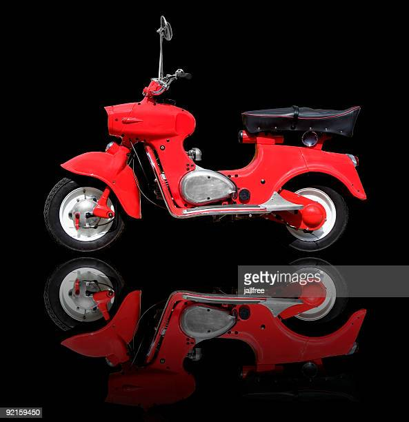 Retro red scooter on black background with path