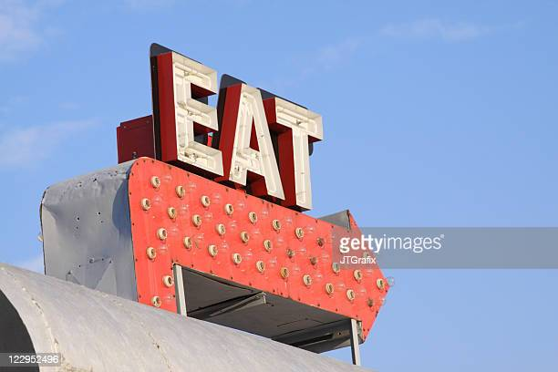 retro restaurant sign that says eat on red arrow - vintage restaurant stock pictures, royalty-free photos & images