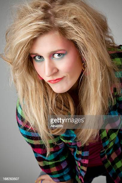 Retro revival: young blond woman with 80s hairstyle and makeup