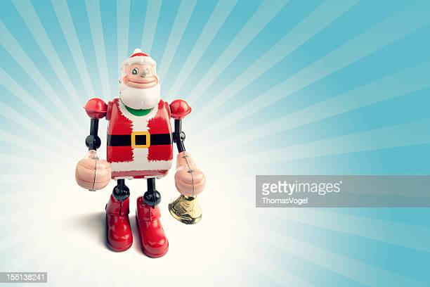 retro santa claus robot - wind up toy stock photos and pictures