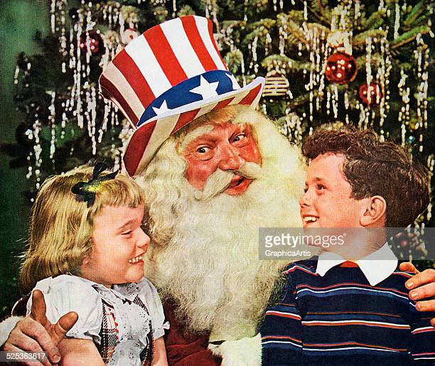 Retro Santa Claus wearing a stars and stripes tophat with a boy and girl sitting on his lap photograph 1949