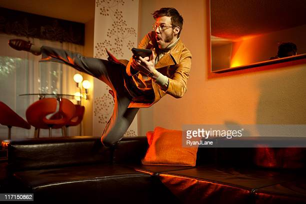 Retro Secret Agent Man Diving Over Couch