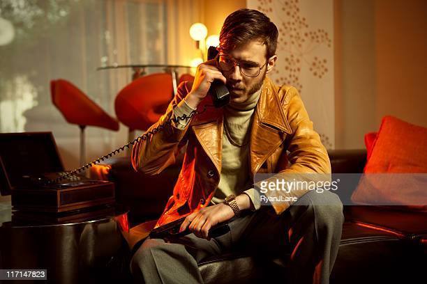 retro secret agent man on telephone - sideburn stock pictures, royalty-free photos & images