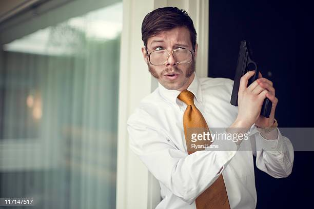 retro secret agent waiting with pistol - sideburn stock photos and pictures
