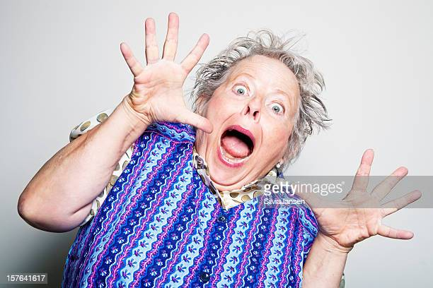 retro senior housewife surprised - fat old lady stock photos and pictures