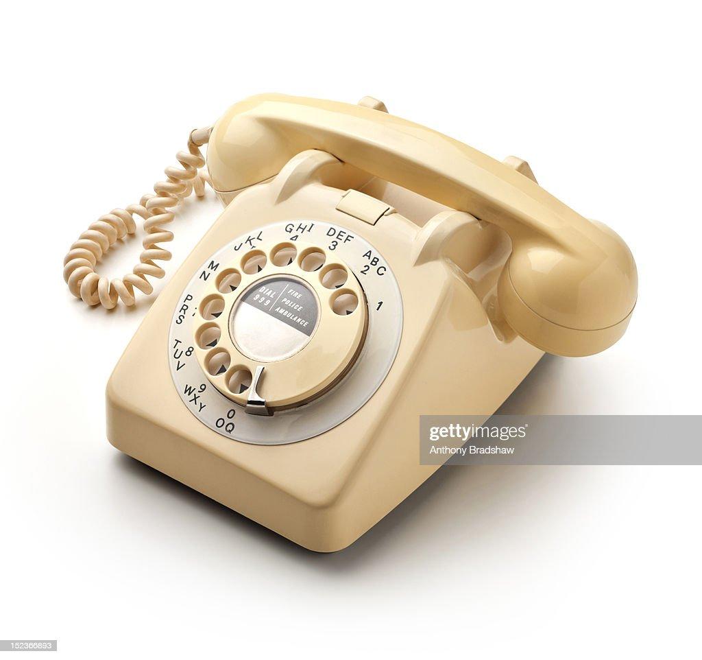 Retro style cream coloured telephone : Stock Photo