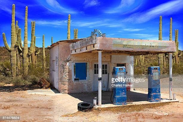 Retro Style Desert Scene with Old Gas Station and Saguaro Cactus