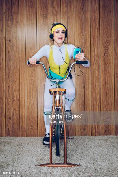 retro style exercise bike woman eighties era - personal stereo stock pictures, royalty-free photos & images