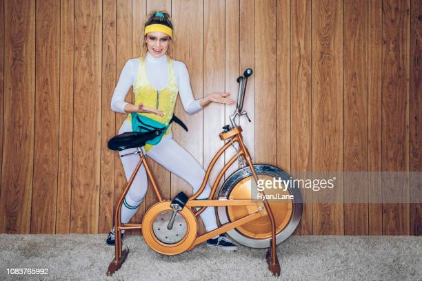 retro style exercise bike woman eighties era - showing off stock pictures, royalty-free photos & images