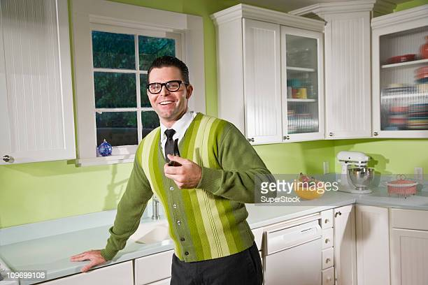 Retro style man at home in kitchen